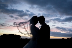 Bride and Groom with Essex sunset